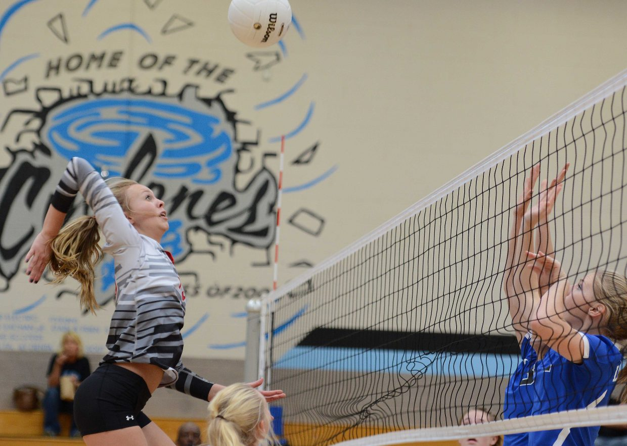 Steamboat senior Erica Yaw knocks the ball Saturday.