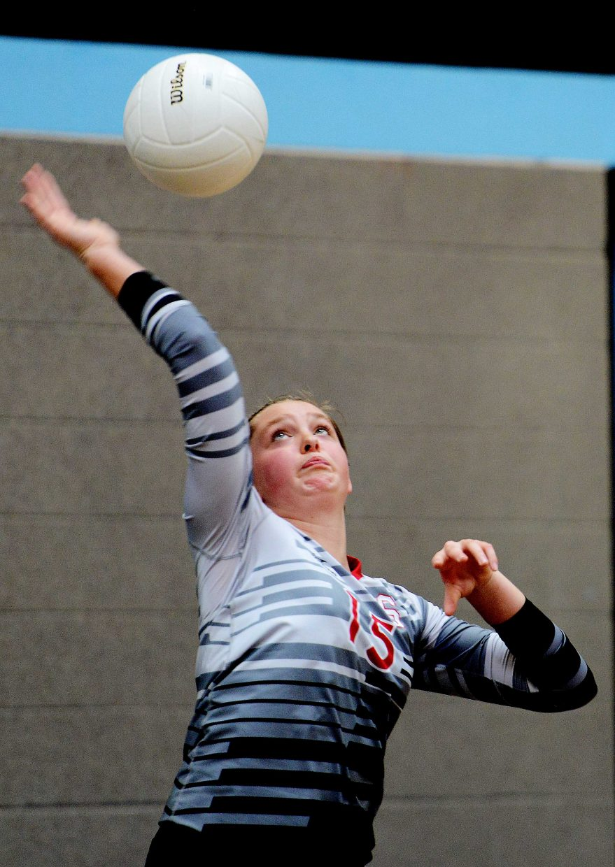 Jenna Miller swings for a serve on Saturday.