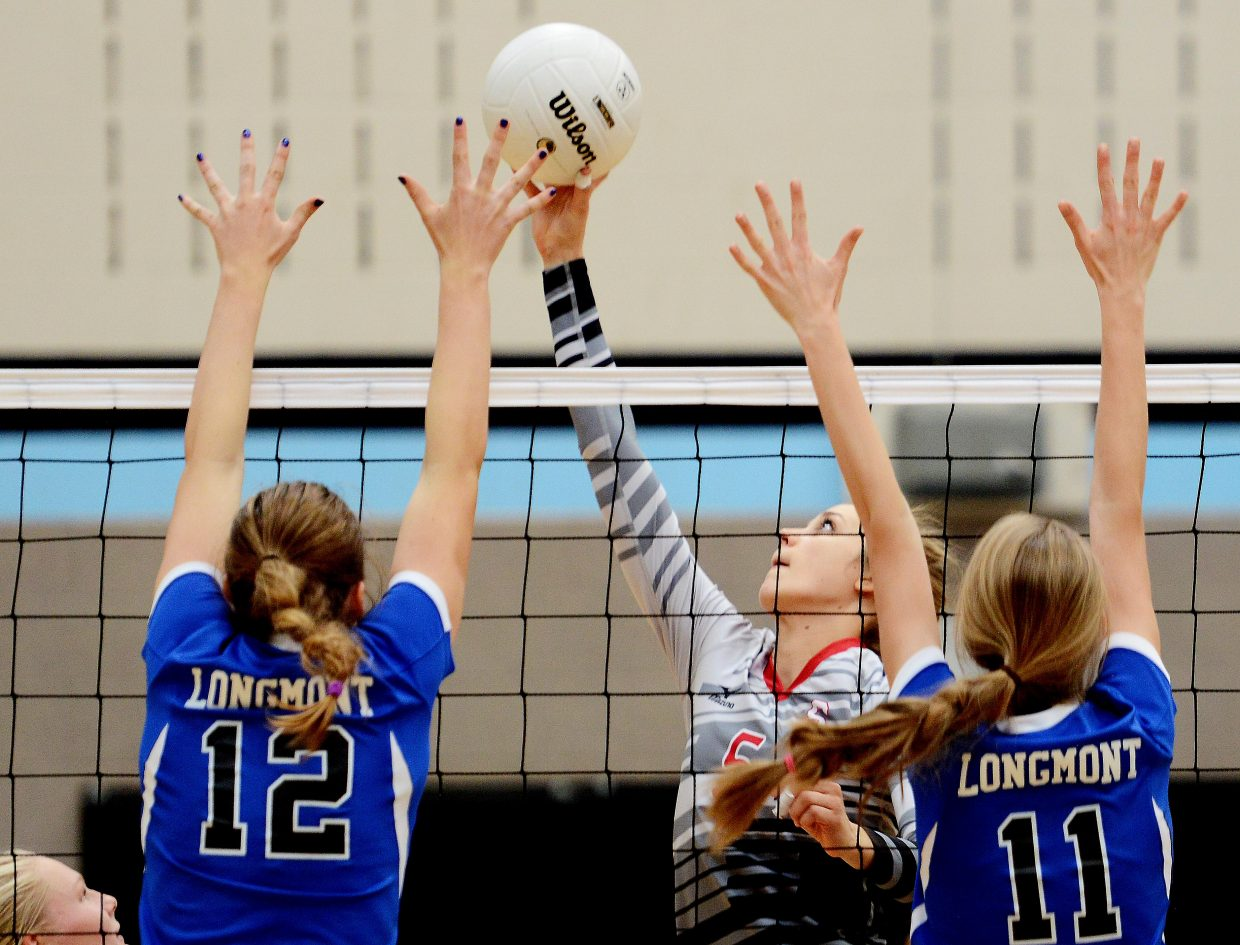 Steamboat's Taylor Harrington taps the ball over Saturday.