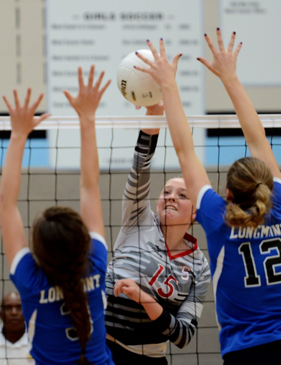 Jenna Miller hits the ball Saturday against Longmont.
