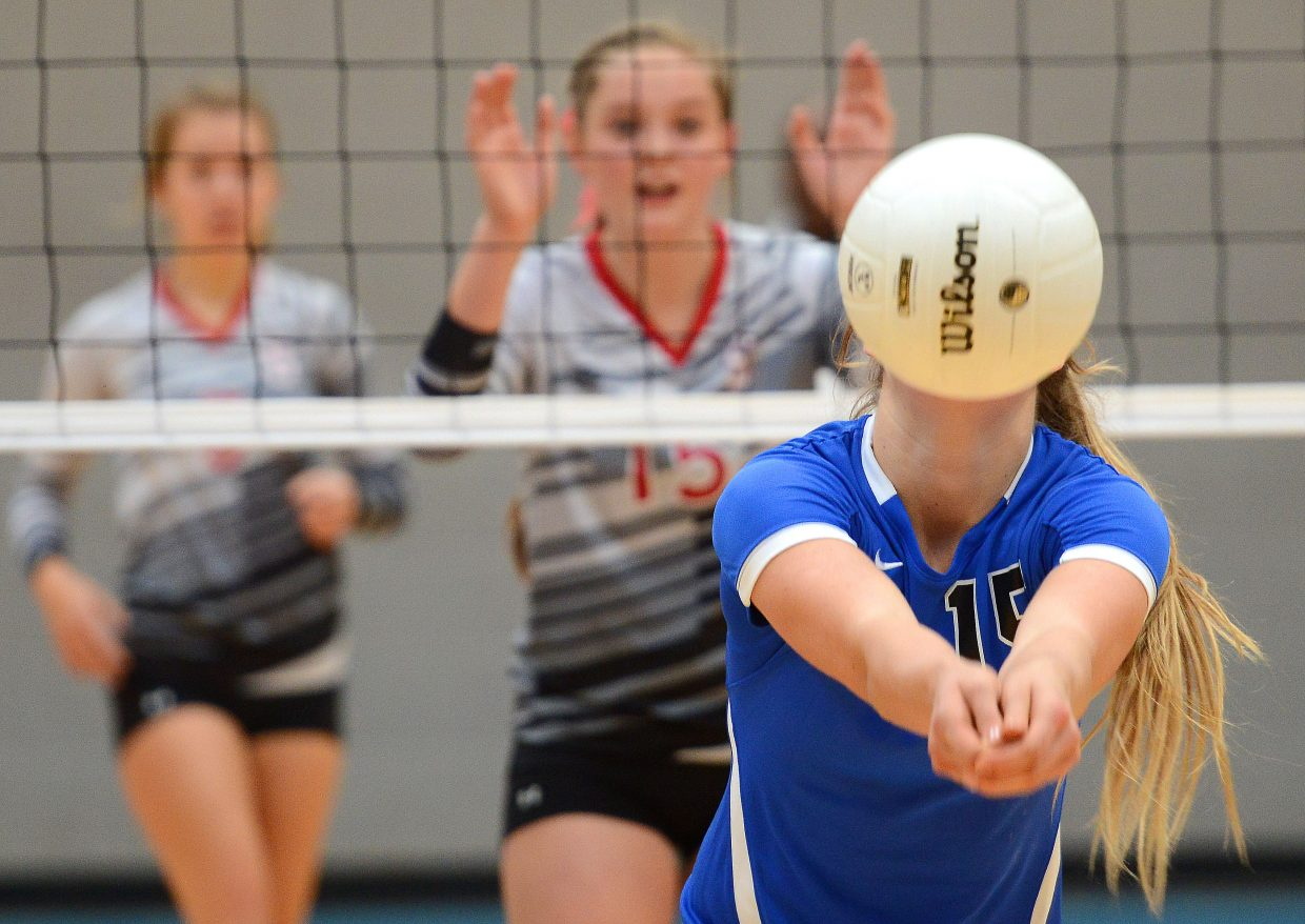 Longmont's Sydney Wetterstrom bumps the ball Saturday.