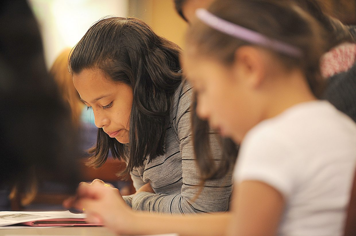 Fifth-grader Jenni Martinez works with other Spanish-speaking students after school during the homework club at Soda Creek Elementary School.