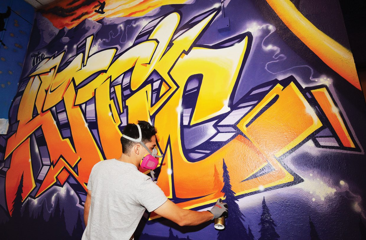 Artist Bimmer Torres puts the finishing touches on a new mural inside the attic at the Boys & Girls Club of Steamboat Springs. Torres painted the mural to help promote #IRiseAbove, which is a campaign that helps deter prescription drug abuse.