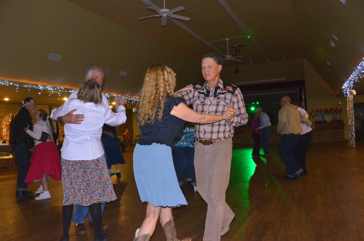"""Couples sway to the sounds of Bobby Darin's """"Mack the Knife"""" during the Sock Hop fundraiser for the Senior Social Center held Saturday night at the Moffat County Fairgrounds Pavilion. The dance for all ages included concessions, door prizes and more."""