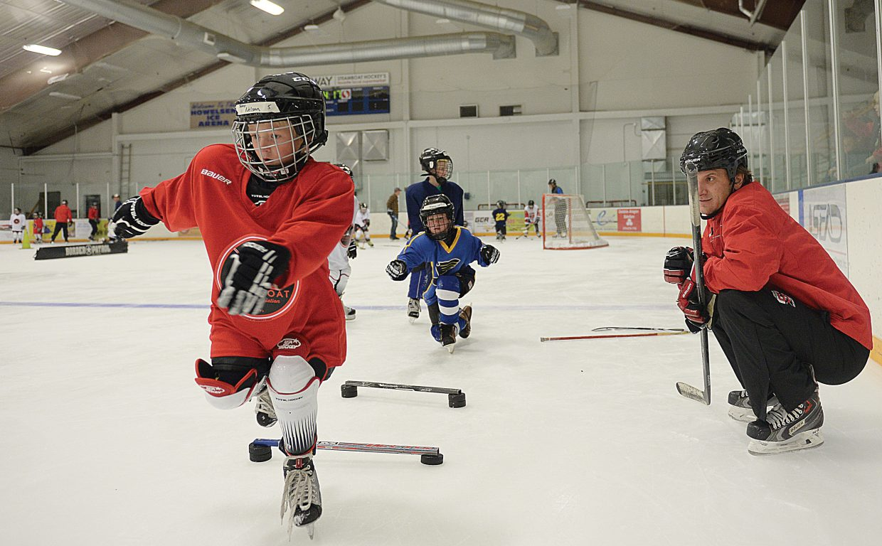 "Joey Nelson navigates an obstacle course designed to improve skating skills while coach Corey Allen watches during the ""Introduction to Hockey"" program being offered through a partnership that includes the city of Steamboat Springs Parks and Community Services, its ASSET programs and the Steamboat Springs Youth Hockey Association. The program, now in the second of eight weeks, is free to the young skaters."