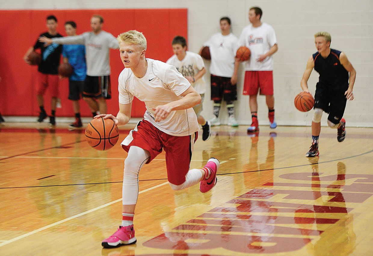 Steamboat Springs senior Ethan Riniker runs through drills with his teammates during a pre-season camp at the Steamboat Springs High School this week. Riniker is expected to be one of the leaders on the court this year for the Steamboat Springs High School boys basketball team.