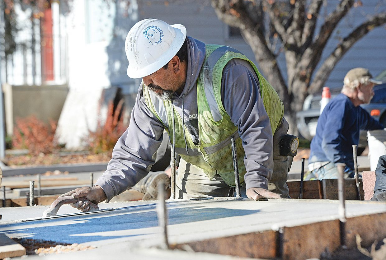 Martin Lopez works on new sidewalks along Oak Street, which are being built as part of a downtown Steamboat Springs improvement plan.