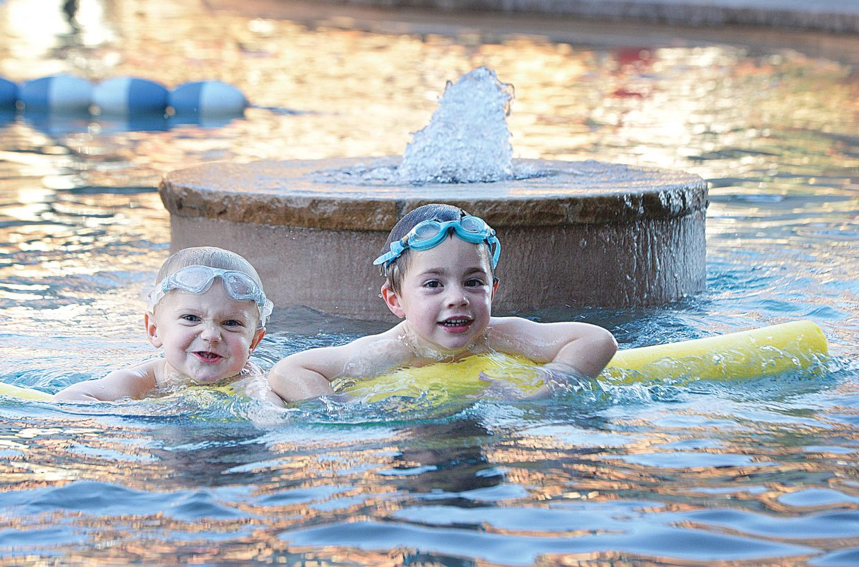Jonathan McKenzie, right, and Cooper Boles hang out together at the Old Town Hot Springs swimming pool Thursday afternoon.