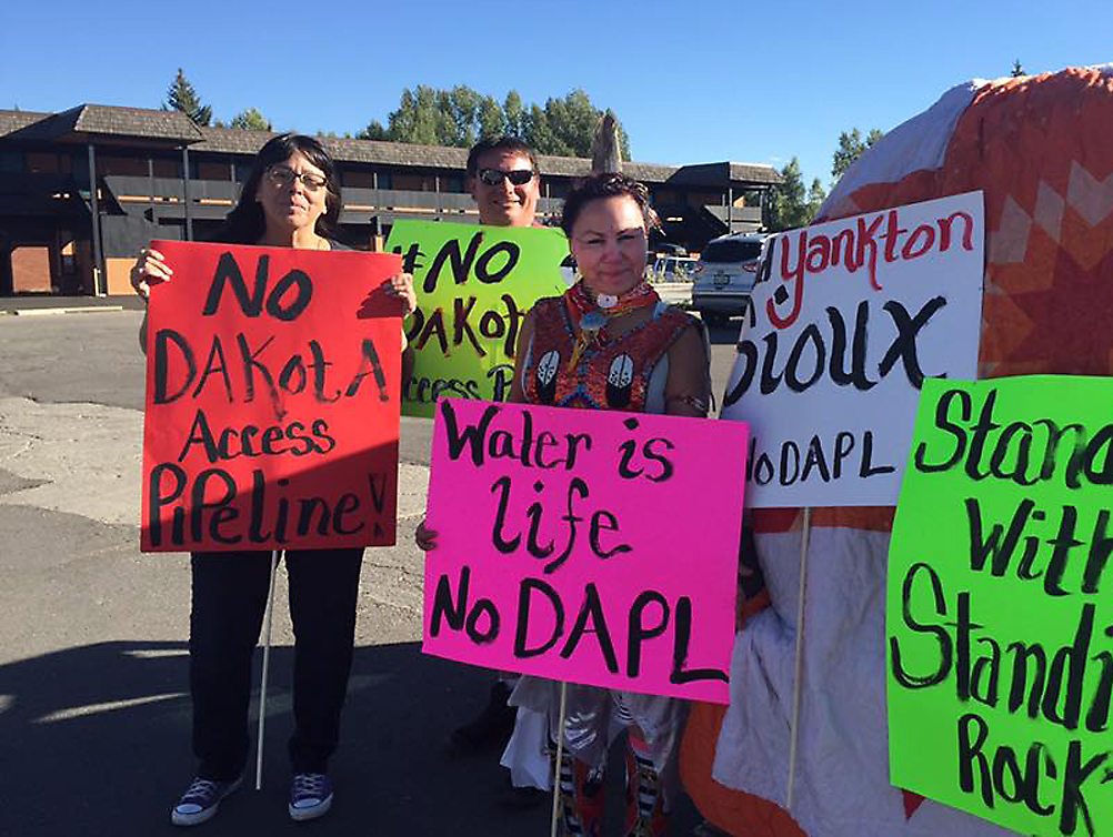 Nancy Brood, left, Joshua Smith and Trizanne Rowley demonstrate their support in Steamboat Springs for the oil pipeline protesters at Standing Rock, South Dakota.