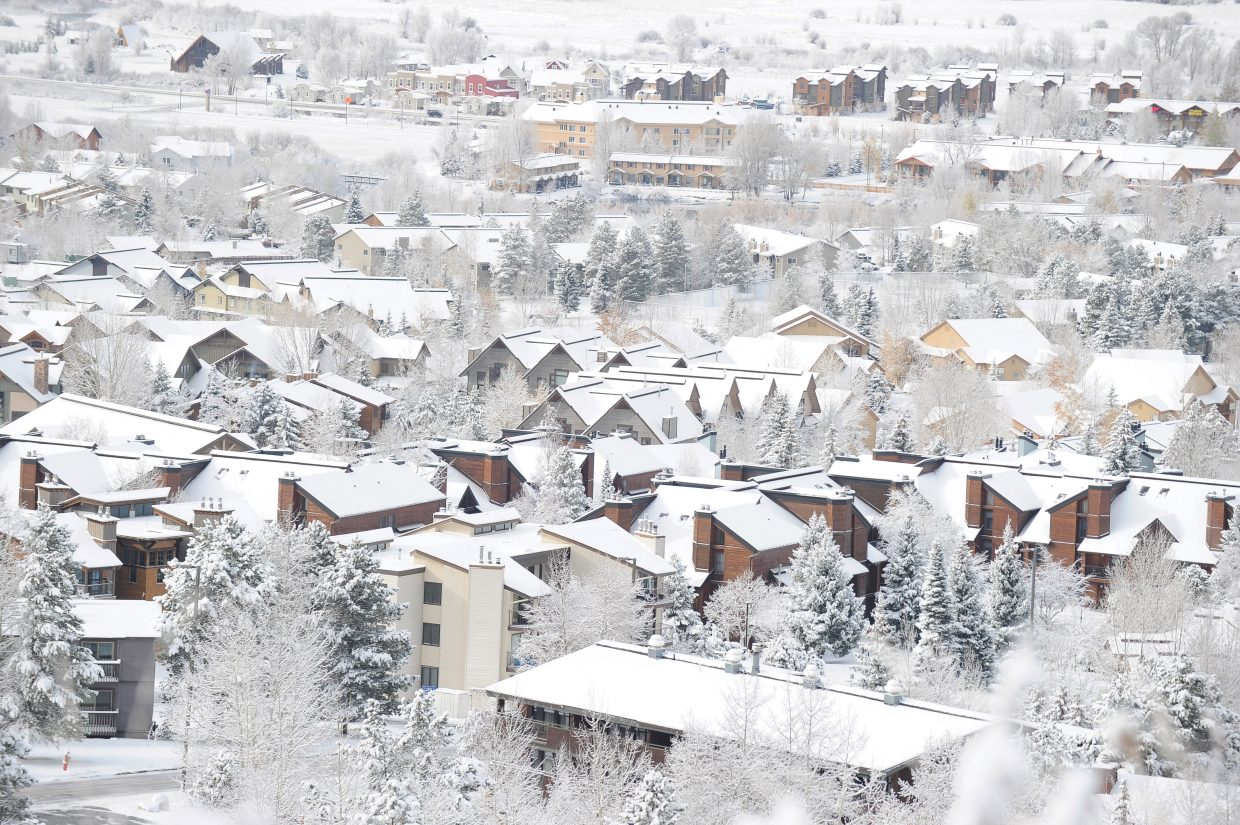 A fresh layer of snow rests on the rooftops of homes near Steamboat Ski Area.