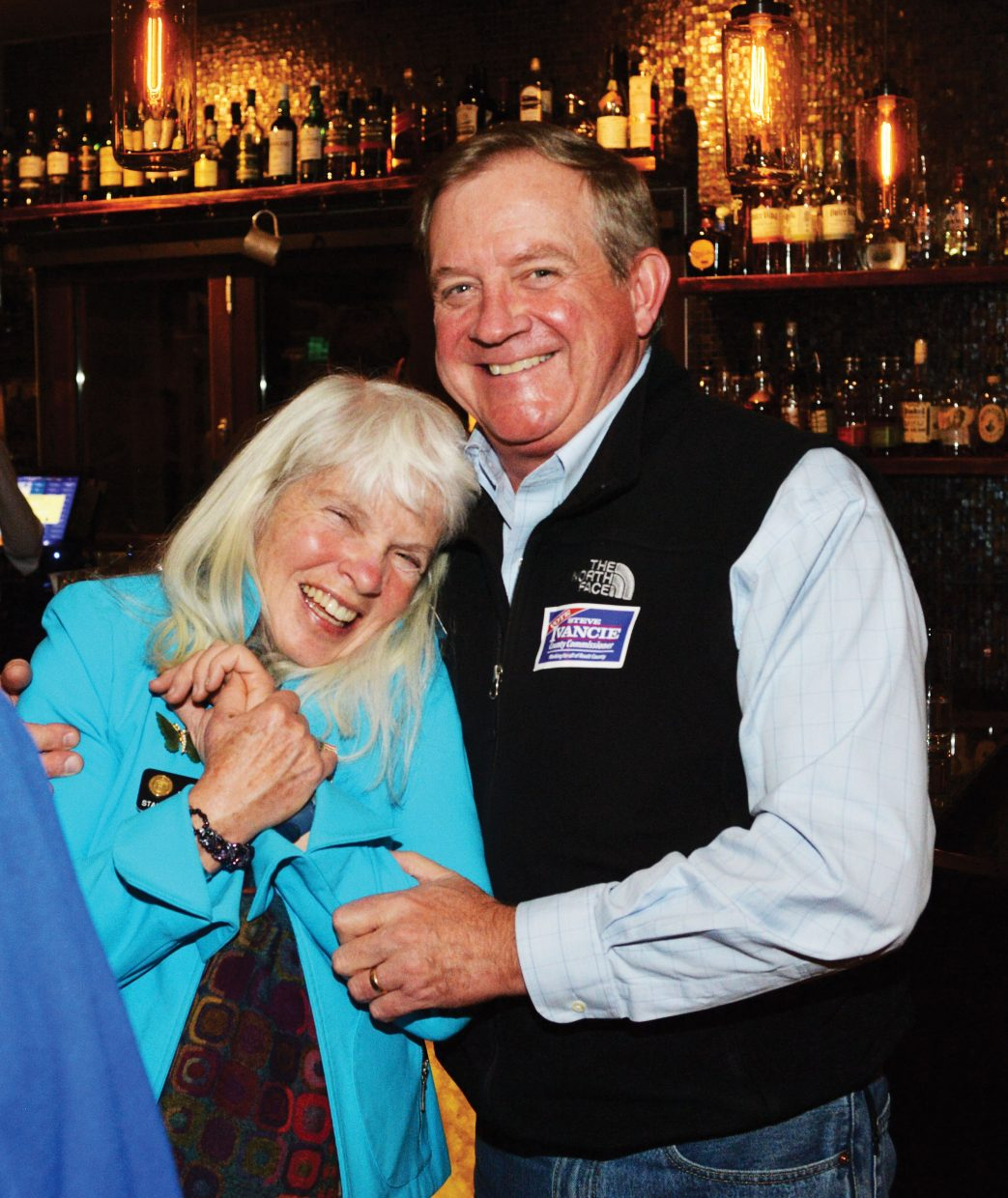 Democrats Diane Mitsch Bush and Steve Ivancie hug at a Democratic watch party at Aurum Tuesday night. Mitsch Bush defeated Chuck McConnell to retain her Colorado House District 26 seat for another term. In an extremely tight county commissioner's race, Ivancie was defeated by Republican Cari Hermacinski.