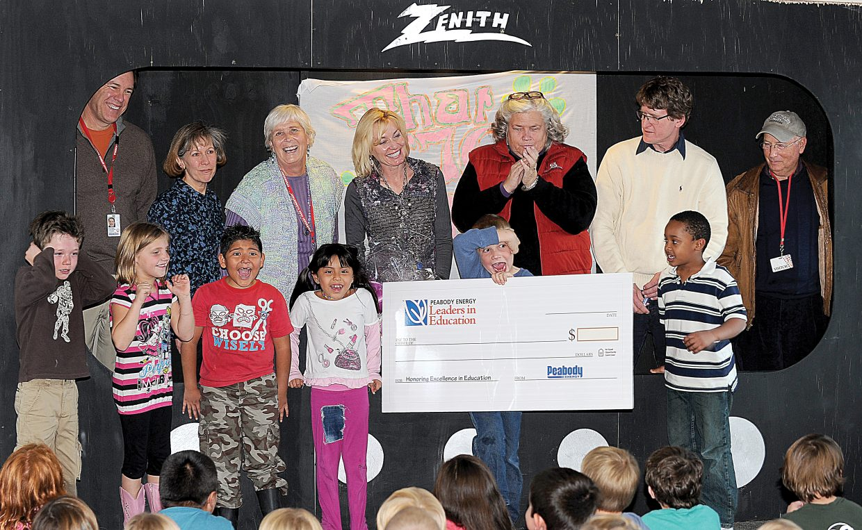 Students at Strawberry Park Elementary School cheer as Allyson Spear, back row middle, is presented with a check for $1,000 as part of Peabody Energy's Leaders in Education program. Steamboat Springs Superintendent Brad Meeks along with committee members Jennifer Berdine and Gayle Dudley are pictured to the left of Spear. Leaders in Education program Director Maureen Moore, Peabody Human Resource Manager Scott Harrell and Steamboat Springs Chamber Resort Association President Tom Kern are pictured to the right of Spear.