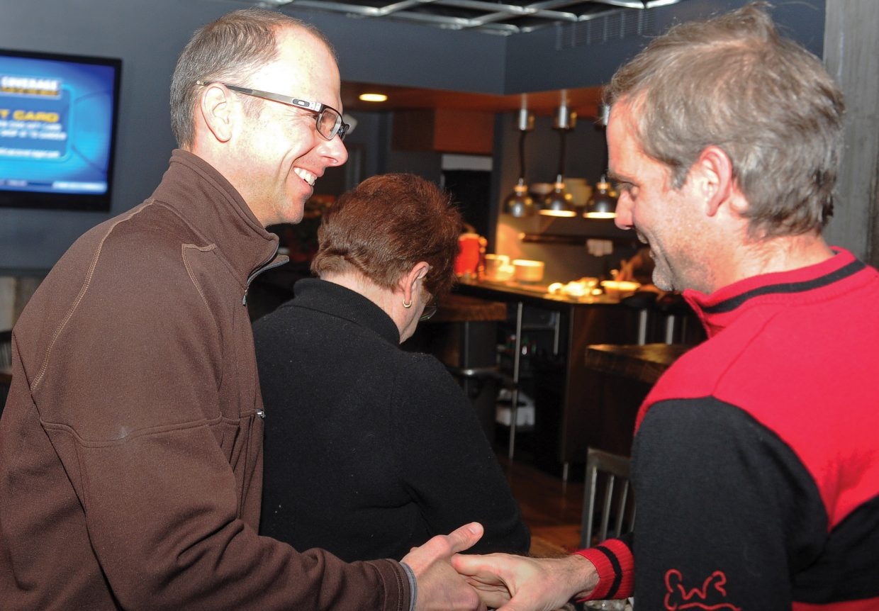 Steamboat Springs City Council member Scott Myller congratulates David Scully after a group of 2A supporters learned the ballot referendum had passed Tuesday evening. The group gathered at Carl's Tavern on Yampa Street in downtown to celebrate the victory.