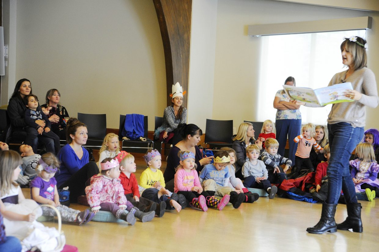 """Carmela LaVignia Coyle reads to children Thursday during a Super Special Storytime at Bud Werner Memorial Library. Coyle is the author of """"Do Princesses Wear Hiking Boots?"""" and """"Do Superheroes Have Teddy Bears?"""""""