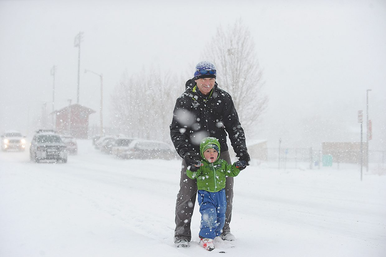 Three-year-old Everett Baldwin and his dad, Tim, make their way to day care Wednesday morning in Steamboat Springs. Everett wanted to make the trip on skis.