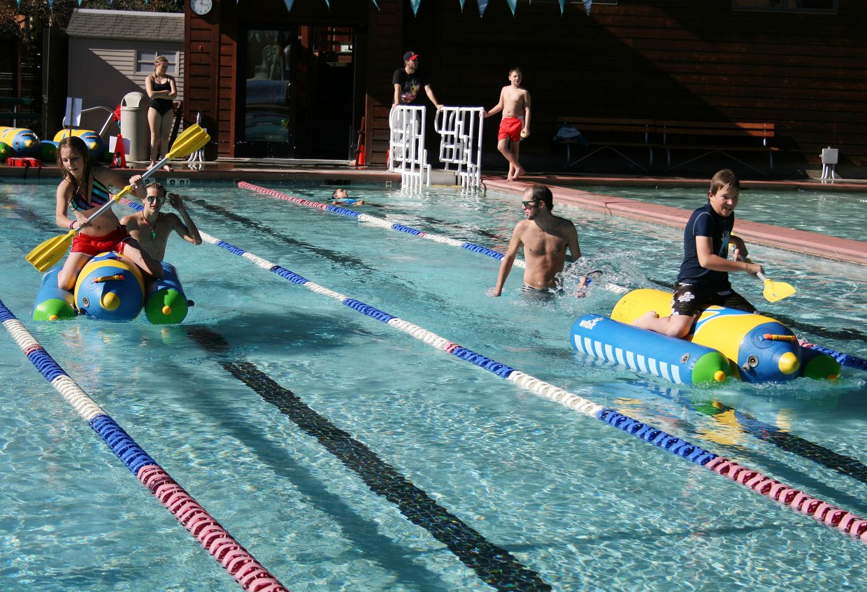 The Old Town Hot Springs was swarming with children Thursday for the Cool Pool Pentathlon, which drew crowds of racers from kindergarten to eighth-grade for a race that included a sprint up the slide stairs, a dash down the slide, a trip on inflatable kayaks across the pool and a desperate lap of swimming.