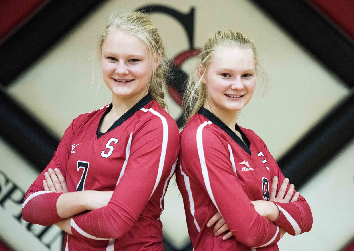 Maritza Wiedel, left, is half an inch taller than her twin sister, Abigail Wiedel. There's little else that separates the Sailors seniors, however, and together and separately they've played vital roles on this year's league championship team.
