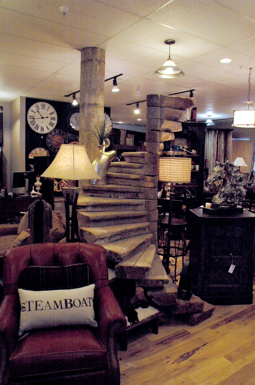 A rustic spiral staircase unearthed from a property in Virginia is the centerpiece of the new Olivia's Home Furnishings in Sundance at Fish Creek shopping center.