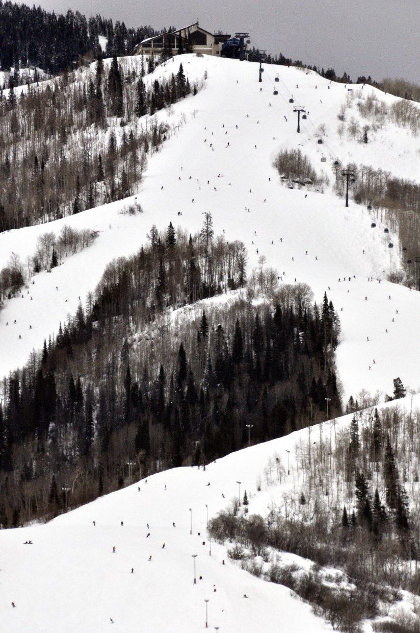 Skiers glide down the slopes of Mount Werner on a busy winter day in February, 2014