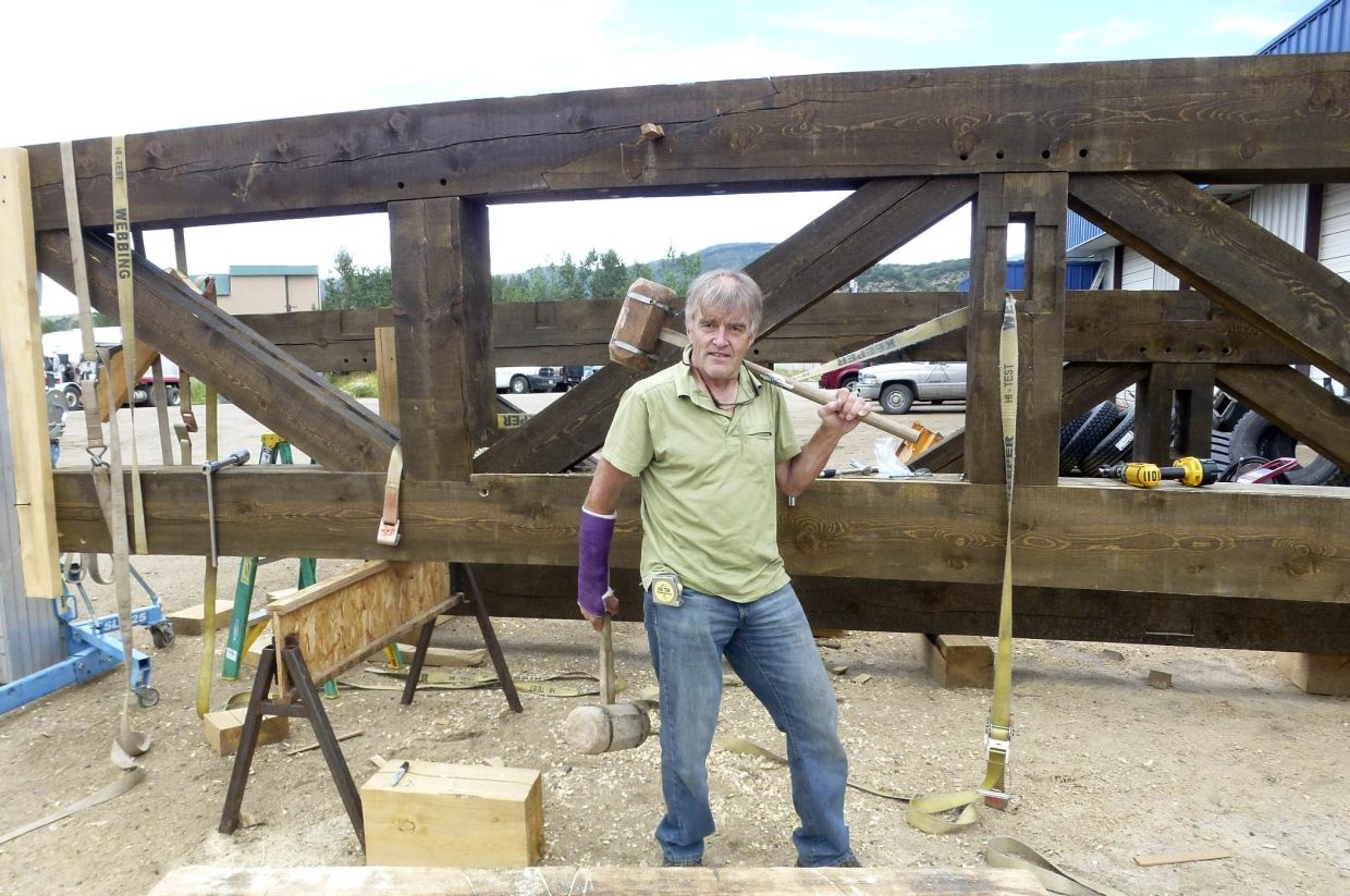 Michael Roberts poses for a picture while working on the Peace Pavilion project along the Yampa River Core Trail.