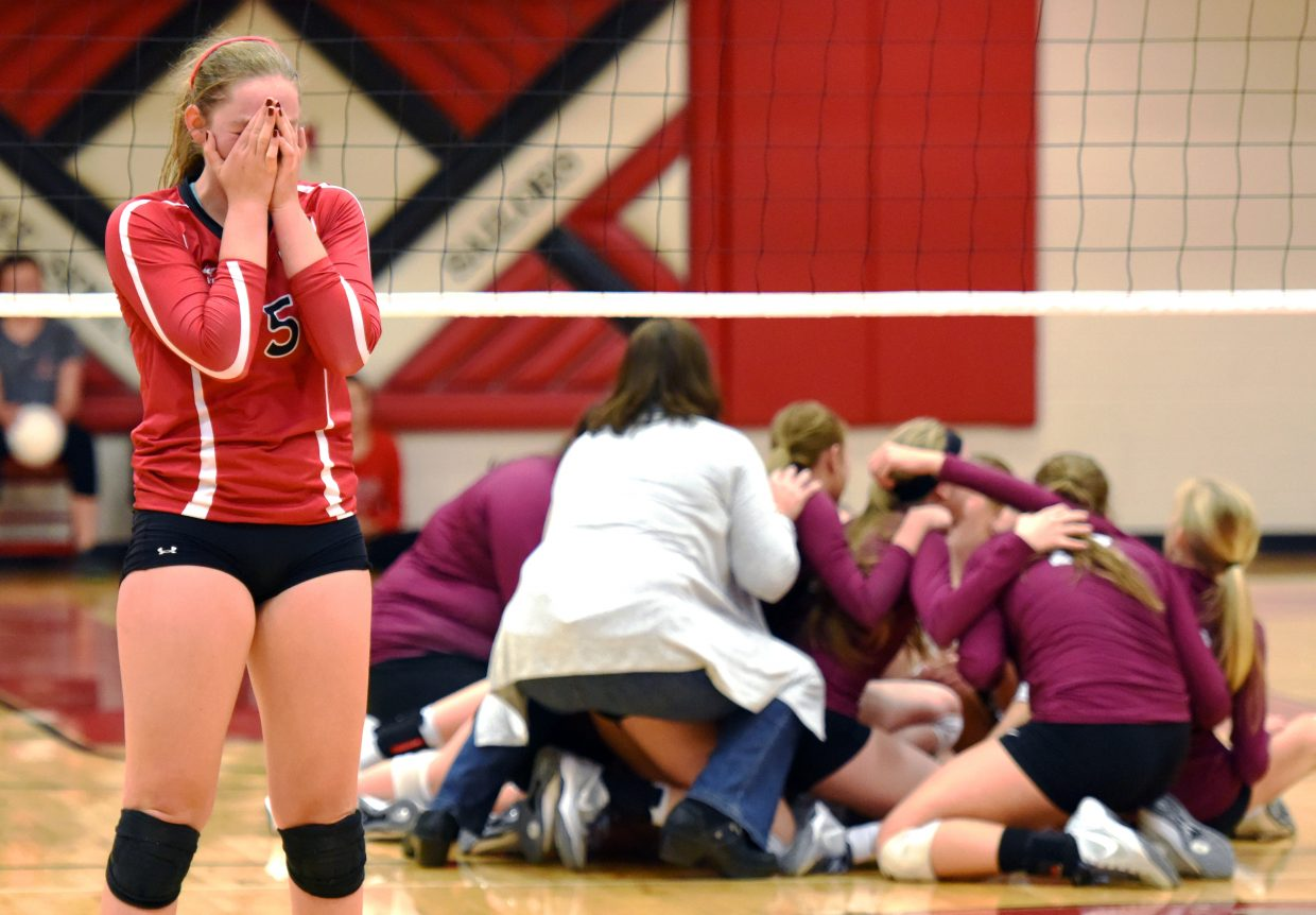 Steamboat senior Jenna Miller buries her face in hands after the Sailors' regional tournament loss to Silver Creek on Saturday.