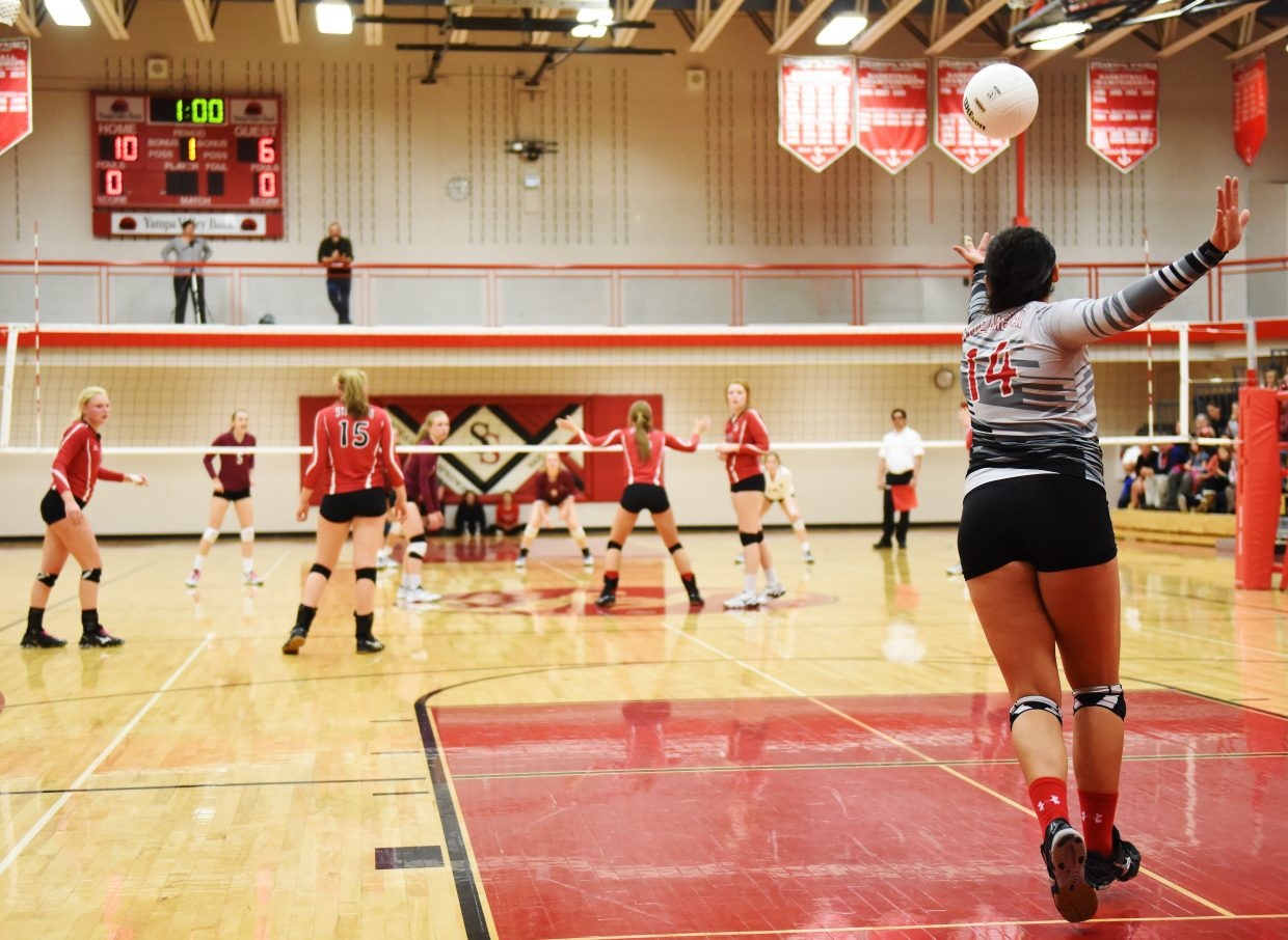 Maddie Labor serves up a ball Saturday against Silver Creek.
