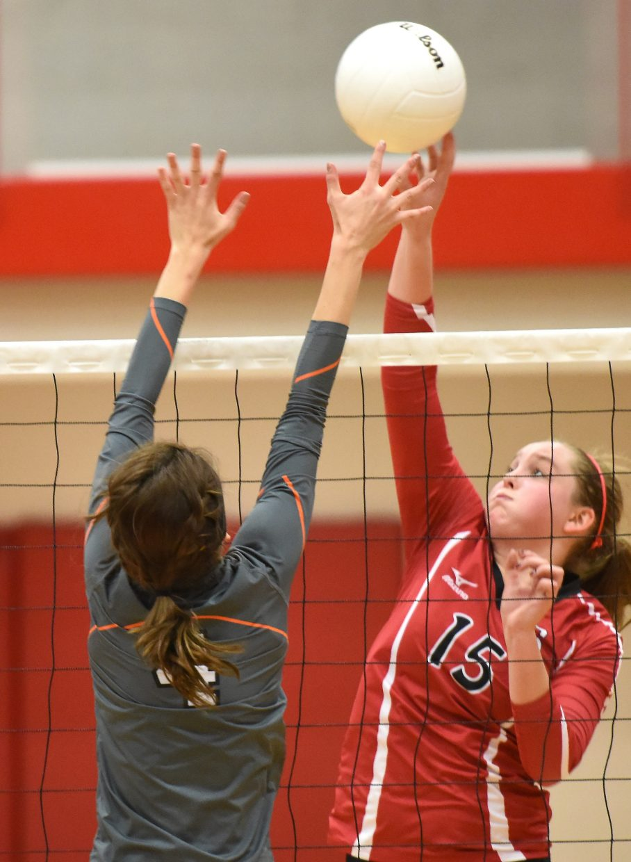 Jenna Miller taps a ball Saturday during the regional volleyball tournament.