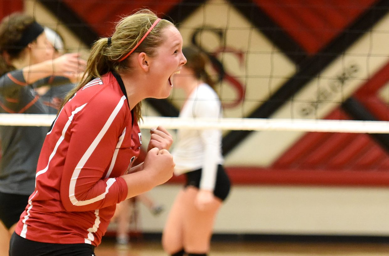 Jenna Miller celebrates a point Saturday during the regional volleyball tournament.
