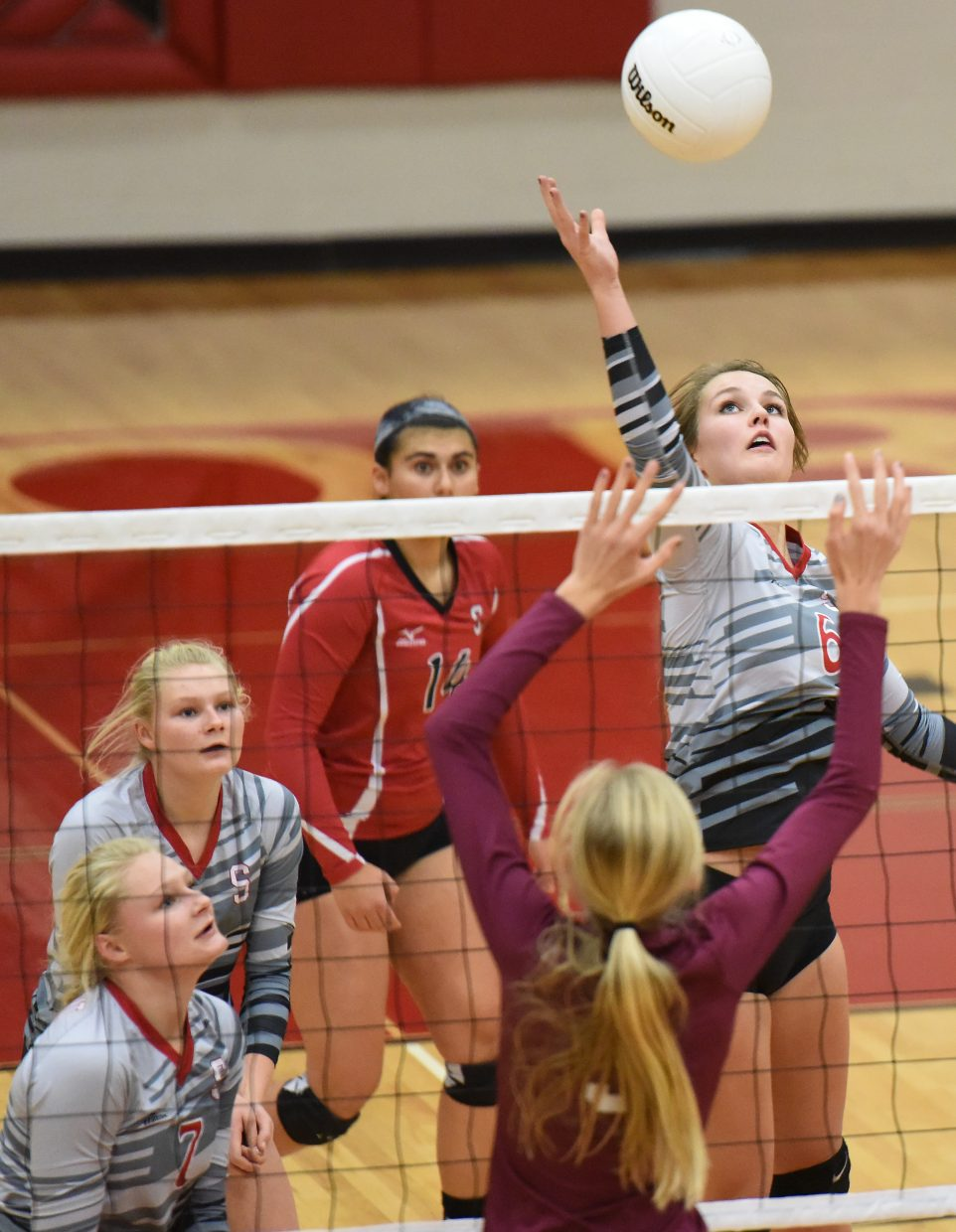 Micah Feeley reaches for a ball Saturday during the regional volleyball tournament.