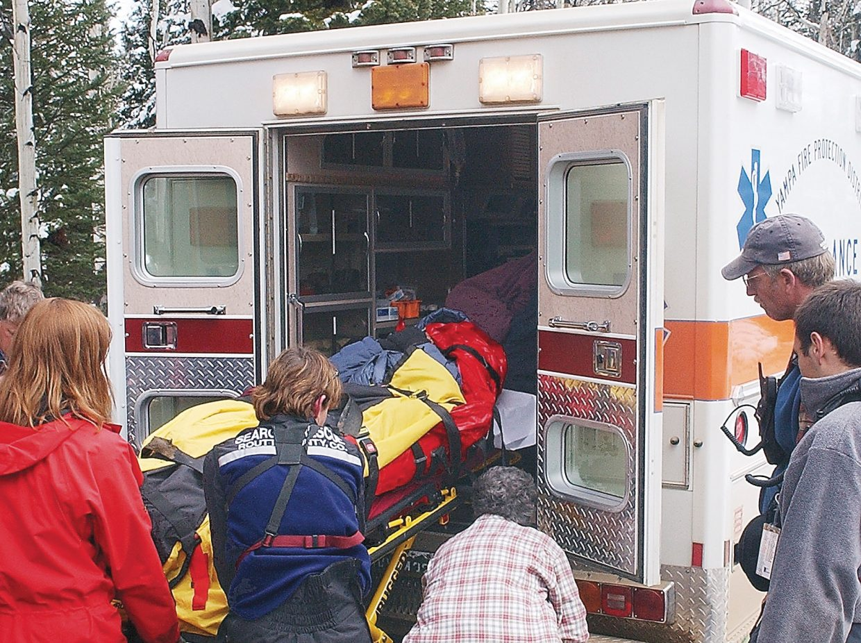"""Charles Horton is loaded into an ambulance after being rescued from an area near Chapman Reservoir in rural northeast Rio Blanco County in 2005. Horton will share his survival story in the TV reality show """"Bear Grylls: Escape from Hell,"""" which will air Monday on the Discovery Channel."""