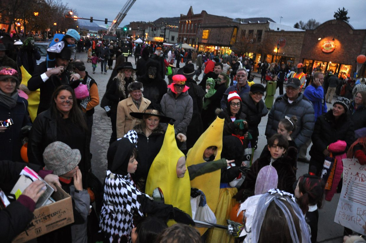 Children participate in a screaming contest downtown Steamboat Springs during the Halloween Stroll.
