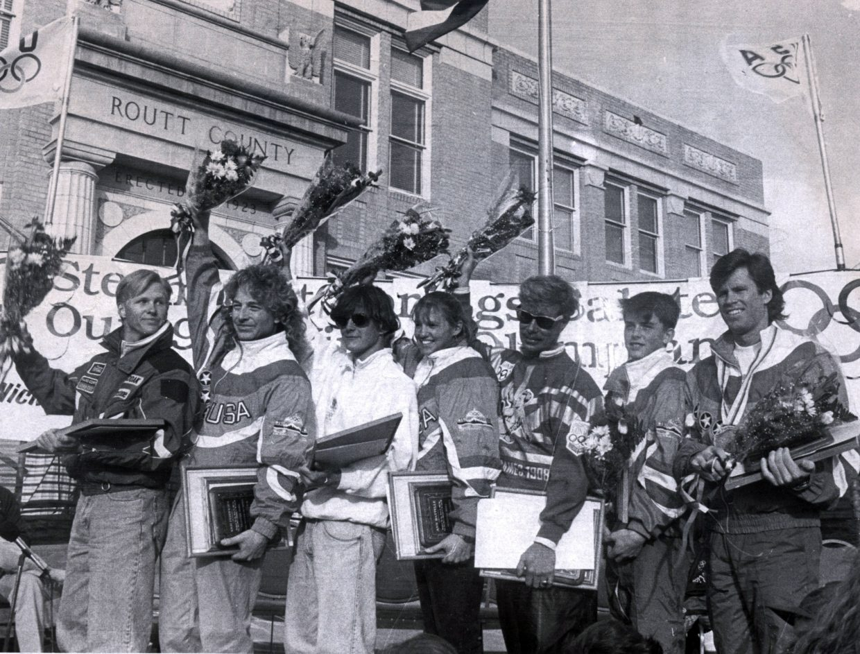 Matt Grosjean, from left, Kris Feddersen, Nick Cleaver, Ann Battelle, Jorge Torruella, Ryan Heckman and Nelson Carmichael pose in downtown Steamboat Springs on April 2, 1992, during an event to celebrate Steamboat's Olympians in that winter's Olympics.