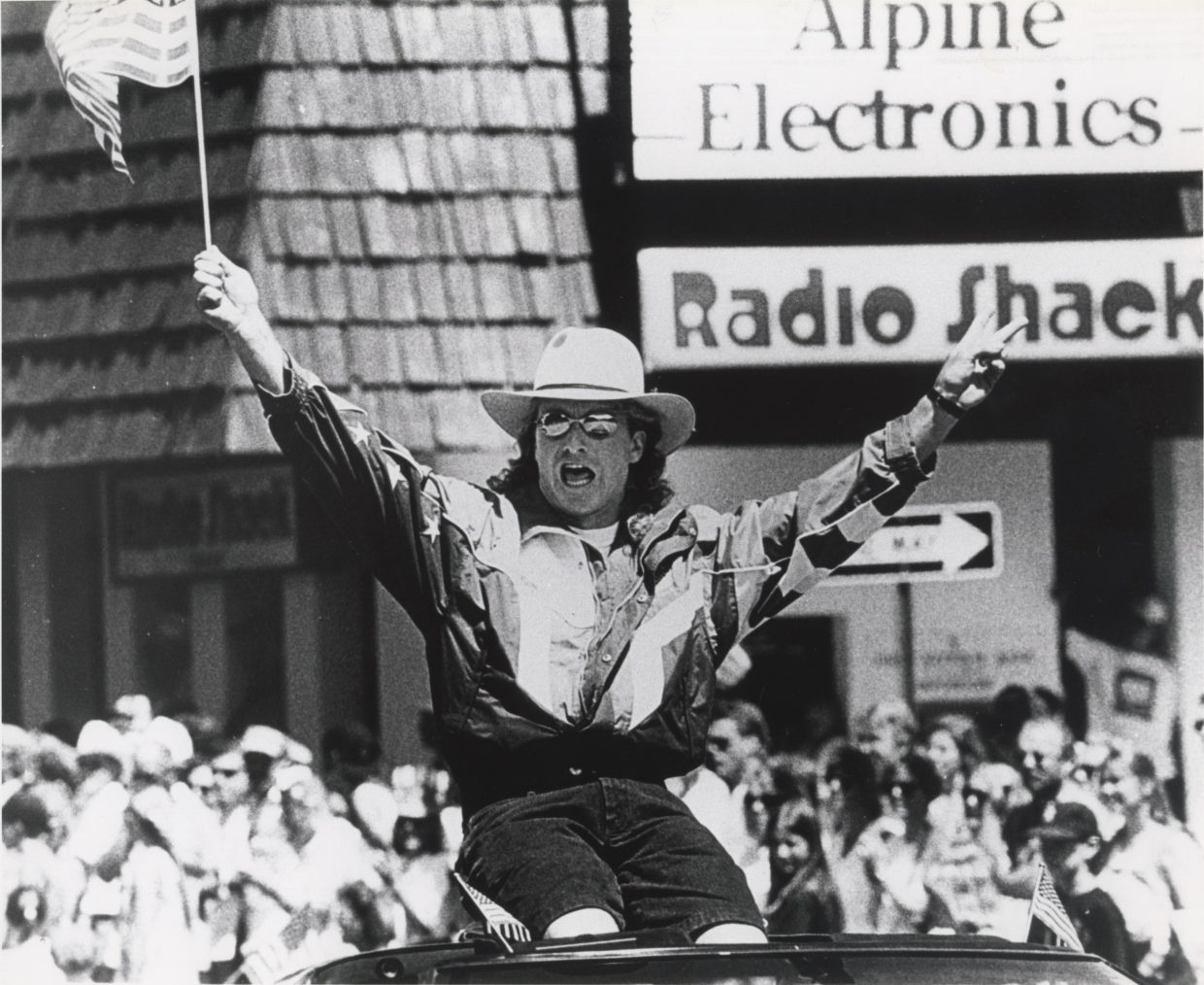 """Steamboat Olympian Kris """"Fuzz"""" Feddersen waves to the crowd during a Fourth of July parade in downtown Steamboat Springs."""