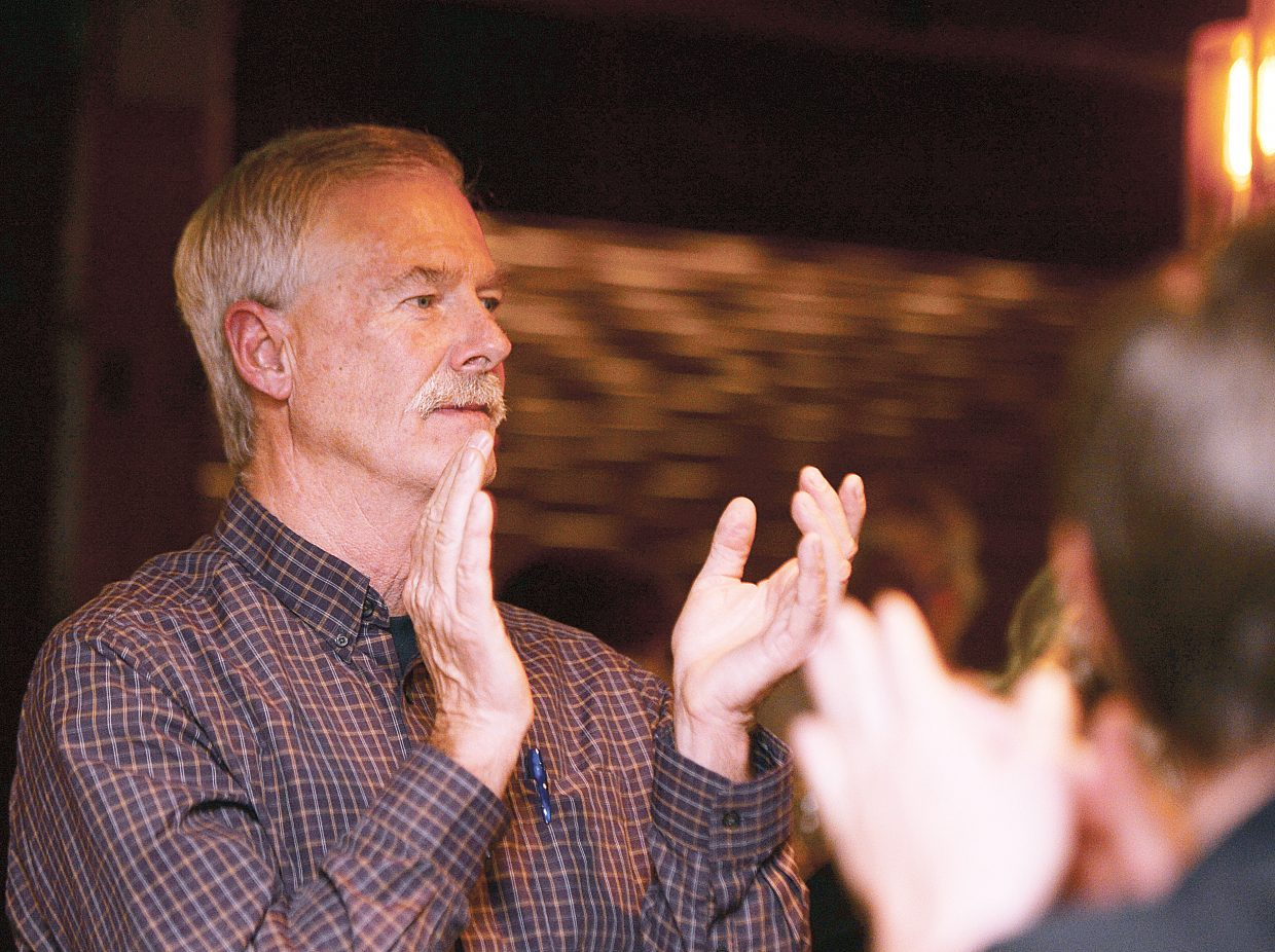 Tim Corrigan applauded after learning he had an early lead in the race for Routt County commissioner Tuesday evening. Corrigan went on to win the race over Republican challenger Bob Dapper.