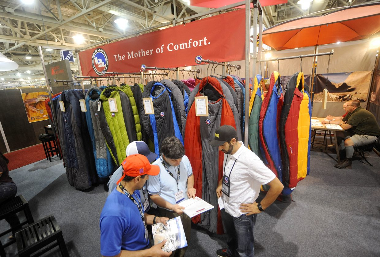 2013 Young Professional of the Year Chris Tamucci, right, pictured at the 2010 Outdoor Retailer trade show in Salt Lake City, was praised by Big Agnes co-owner Bill Gamer for his ability to balance work, family and his love for the outdoors.