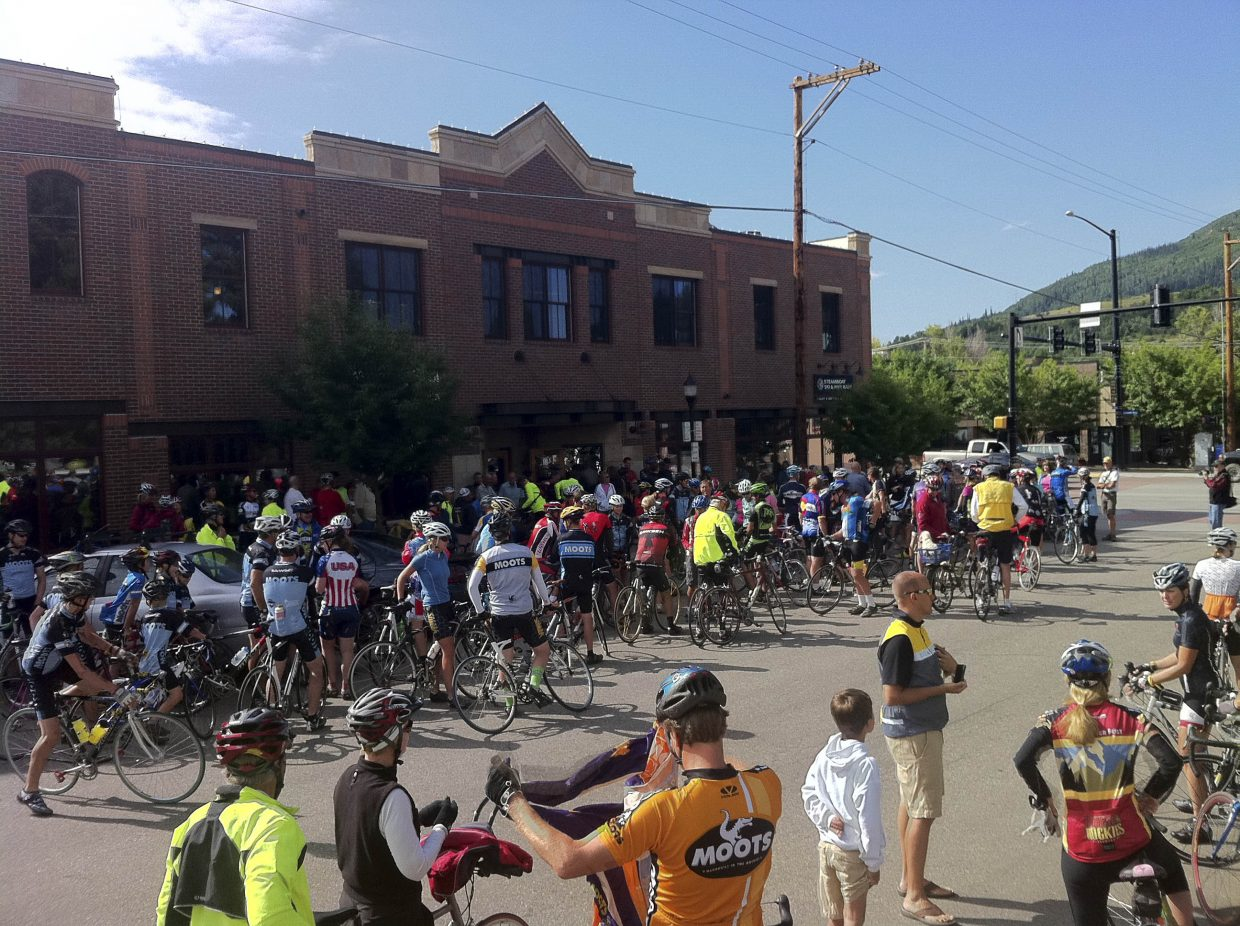 Cyclists wait outside Steamboat Ski & Bike Kare in 2011 for a community ride with Andy Schleck, who won the 2010 Tour de France. Ski & Bike Kare is the 2013 Business of the Year.