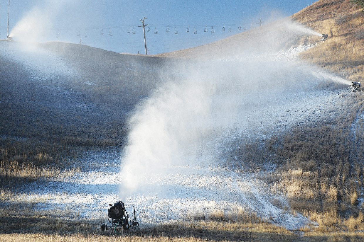 Snowmaking guns blow manmade snow on the slopes of the Howelsen Hill Ski Area Wednesday morning. Both Howelsen Hill and Steamboat Ski Area started making snow early Wednesday morning.