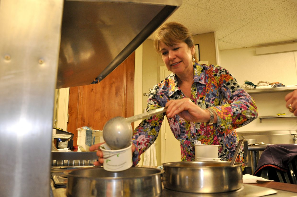 Shelly Shea dishes up some soup Thursday night at a workshop about making healthy soup.