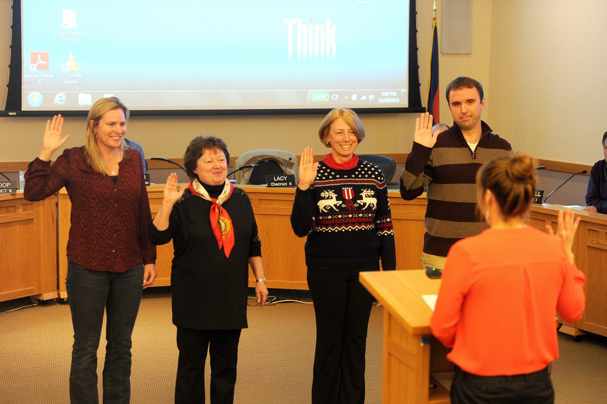 City Clerk Julie Franklin administers the oath of office to new Steamboat Springs City Council members, from left, Heather Sloop, Kathi Meyer, Robin Crossan and Jason Lacy. Lacy and Meyer voted to seek more information about the police investigation, while Crossan and Sloop voted against the effort.