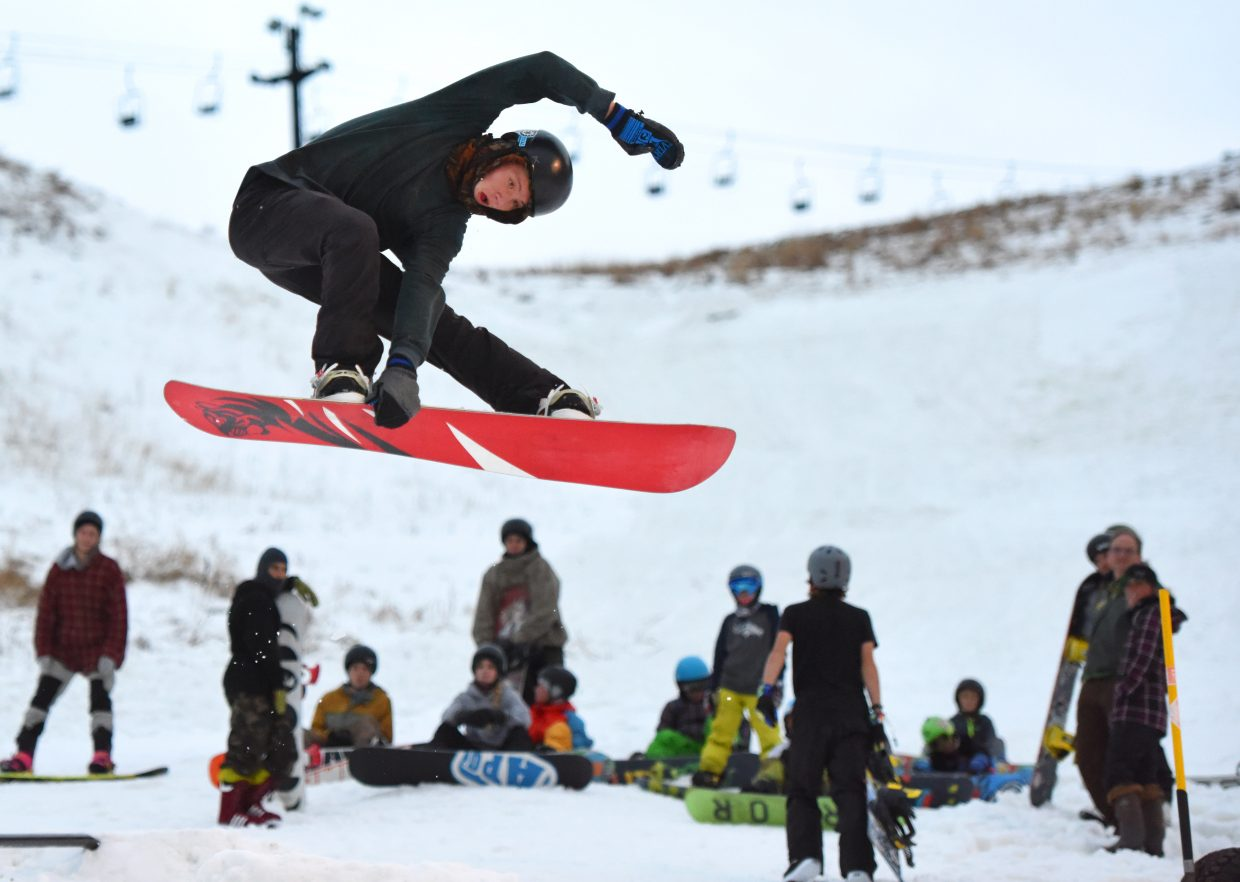 Spencer Vaughan flies high off a kicker Tuesday afternoon as he and other Steamboat Springs Winter Sports Club freestyle snowboarders kicked off their season. There wasn't much to shred, just a small patch of snow at the base of Howelsen Hill spotted by a few rails, but it was enough.