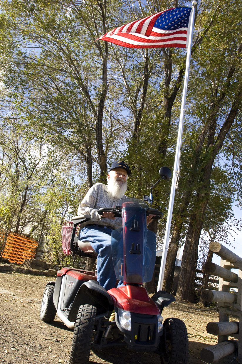 World War II veteran Bob Nicodemus sits below the flag in his front yard on his instantly recognizable red scooter that he uses to commute around Craig and even as far as Cedar Mountain. Nicodemus is a Moffat County native who served three years in the U.S. Navy before returning home to an industrious life as a farm equipment store owner, rancher and mason.