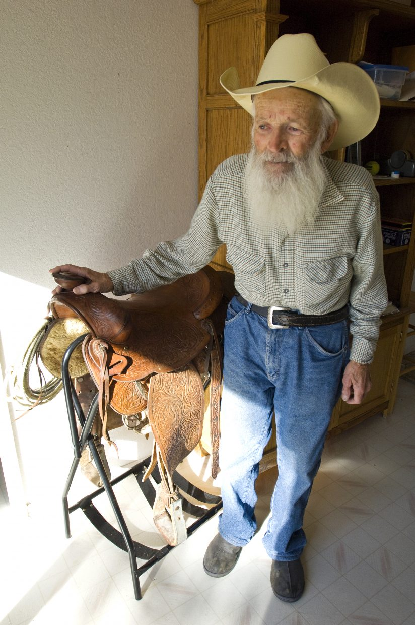 Moffat County native Bob Nicodemus stands next to one of his most prized possessions, a fine saddle that was a gift to him from his late wife, Berdena. The Nicodemus' ran livestock starting in the '50s and made their living off their ranch for about a decade from the mid-'60s to mid-'70s.