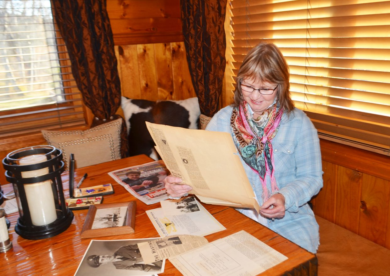 Bonnie Adams Deeds, of Steamboat Springs, looks over historical newspaper clippings and other documents found in a box in Hastings, Michigan, along with her father's Purple Heart from World War II.