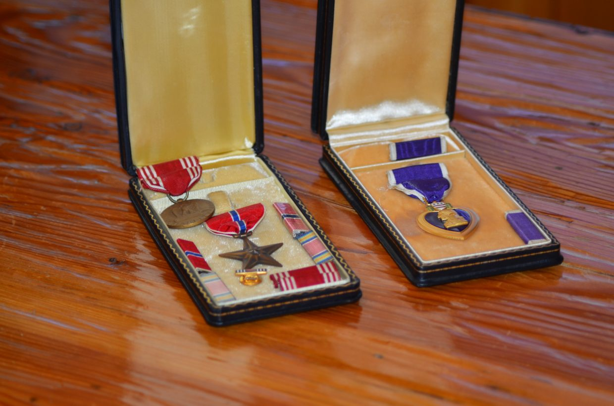 A Bronze Star, left, and a Purple Heart, won by Richard D. Adams, were found in their original boxes.