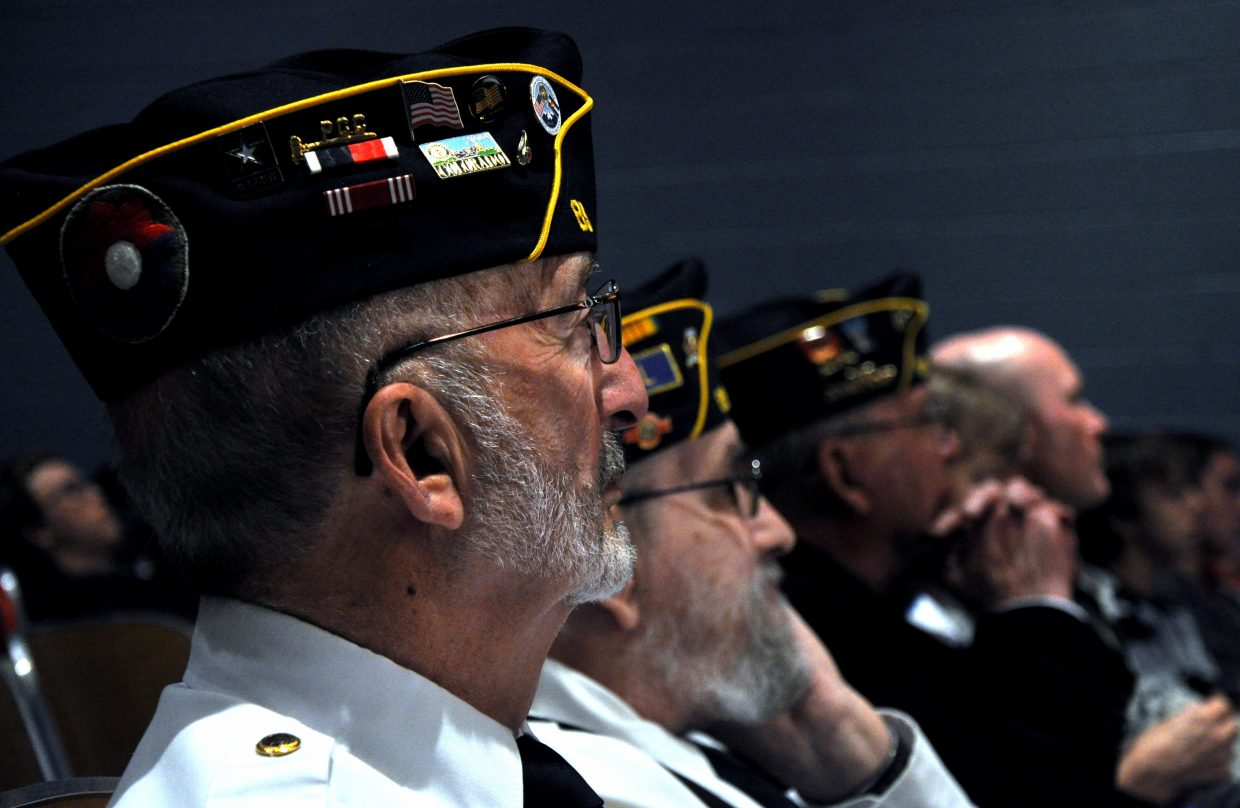 Hayden veterans watch a slideshow honoring them on Monday during Veterans Day at Hayden High School. The town had multiple generations of veterans in attendance and thanked them for their service.