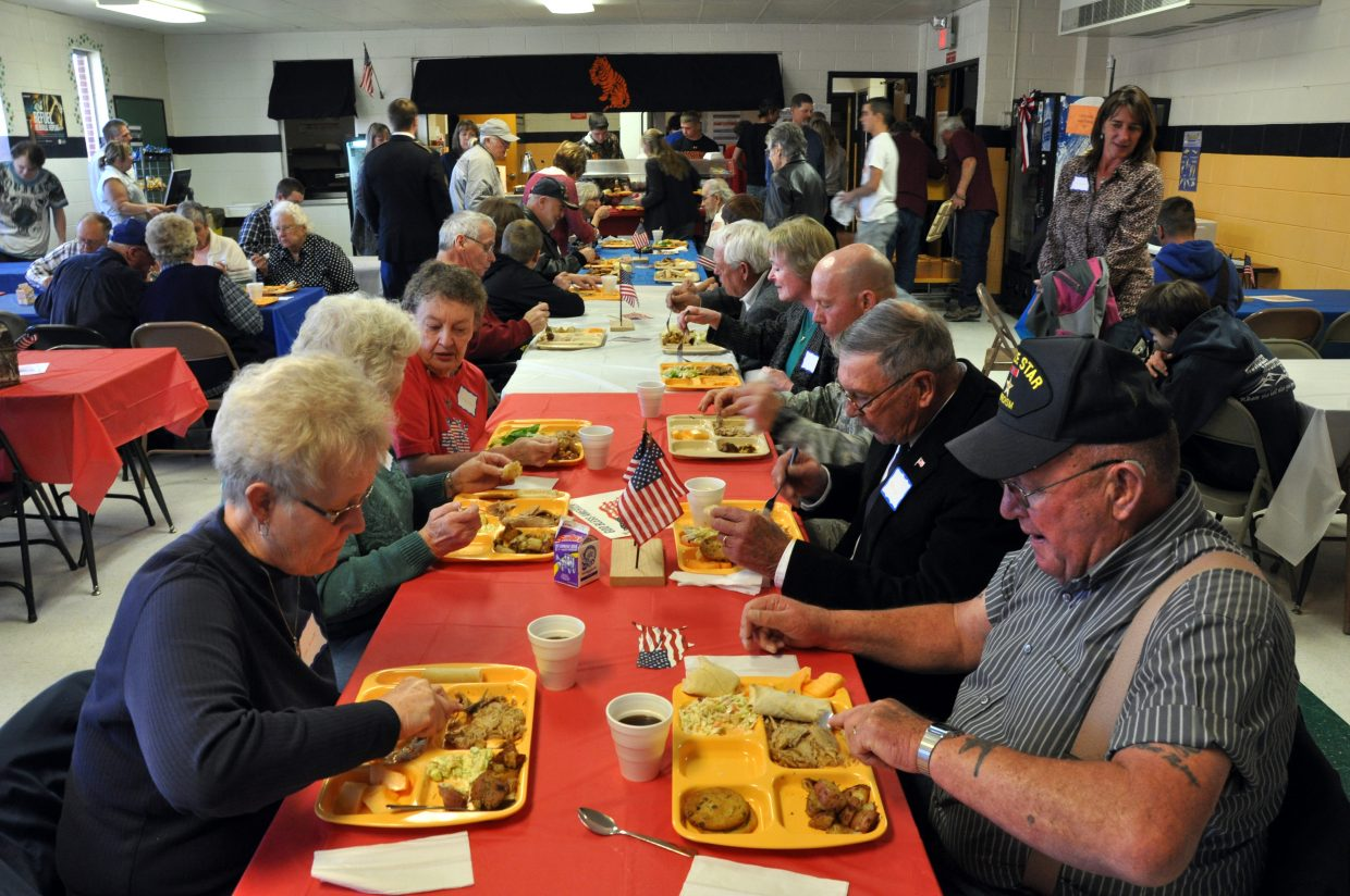Veterans chow down together on a complimentary meal served at Hayden High School. The veterans were honored during a presentation.