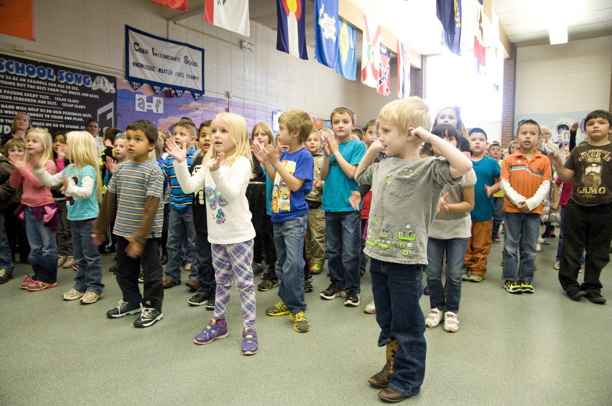 Sandrock Elementary students in Craig sing the Sandrock song to conclude their Veterans Day program Tuesday.