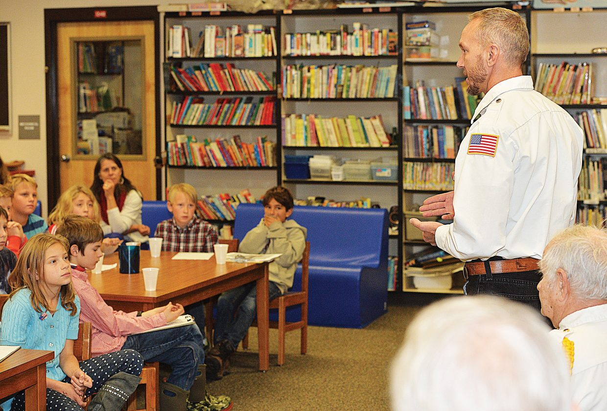 Veteran Nate Daughenbaugh talks with a select group of fifth grade students at Strawberry Park Elementary School on Tuesday morning. The fifth grade students were selected because they are in a leadership group, or have family members that are veterans.