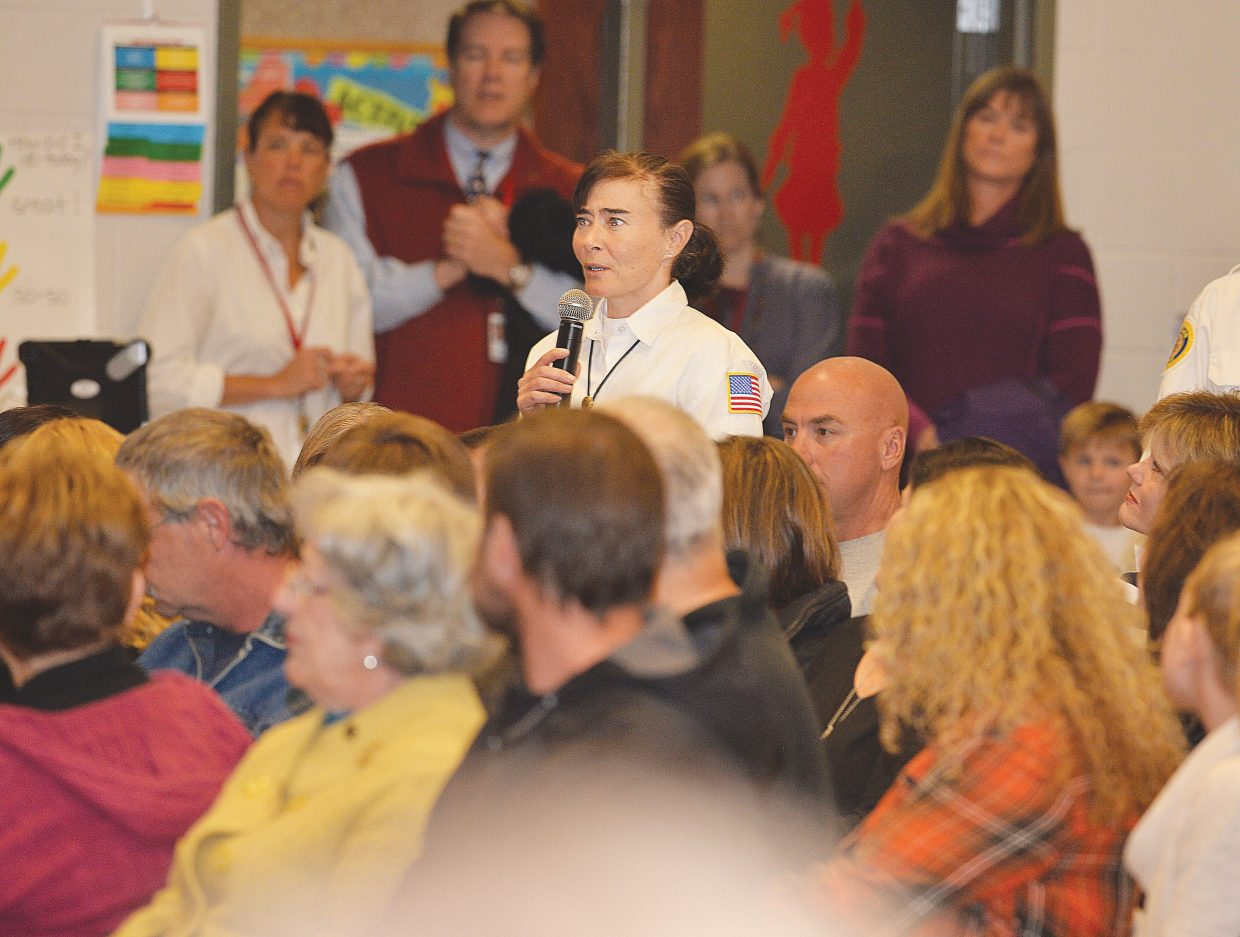 Veteran Tina Kiprios stands up and addresses the large crowd gathered inside the Soda Creek Elementary School's auditorium Tuesday during a Veterans Day program. Kiprios was one of dozens veterans on hand for the program, which was presented by the fifth grade class.