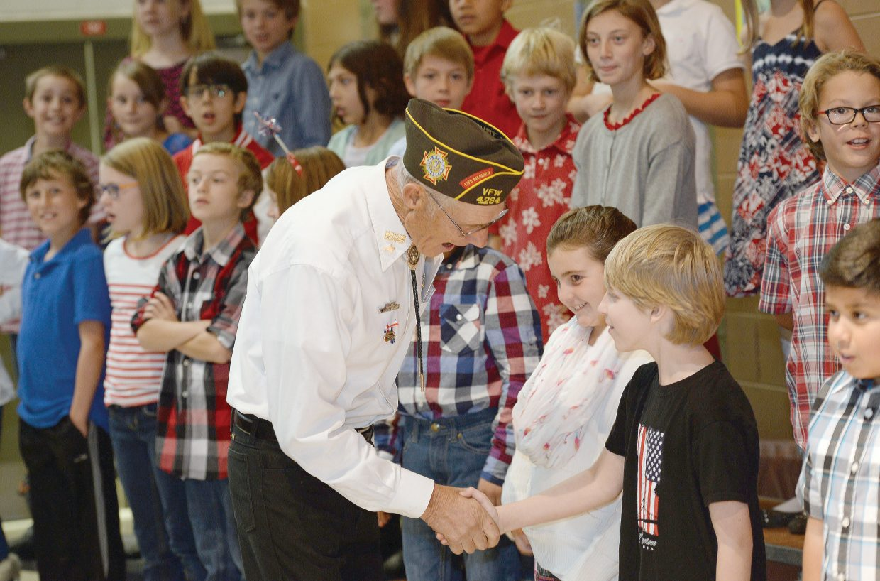 Veteran Fred Sandelin shakes hands with fifth graders at Soda Creek Elementary School prior to the students' Veterans Day Program. The children sang songs and read passages to honor the men and women of Routt County who have served their country as part of the military.